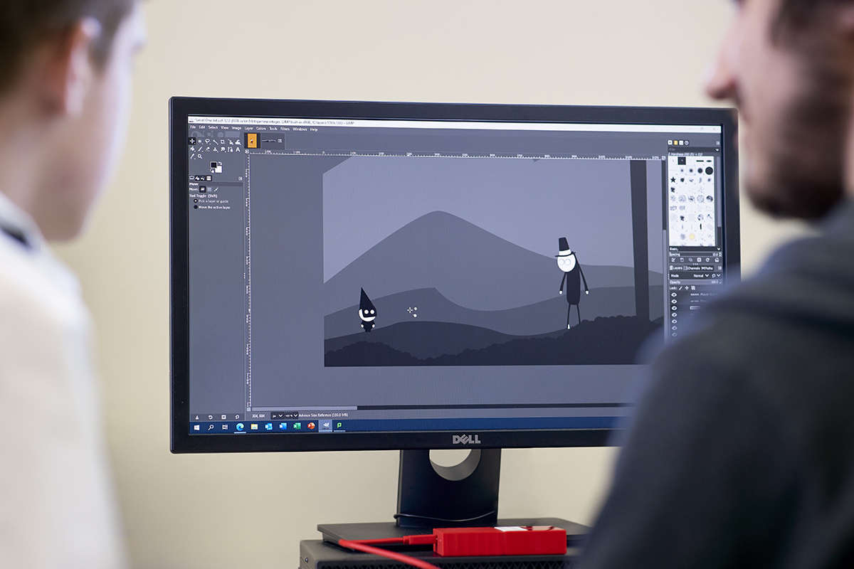 Game development student on computer