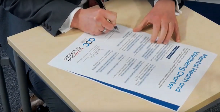 Lee Probert signing the Mental Health Charter for York College
