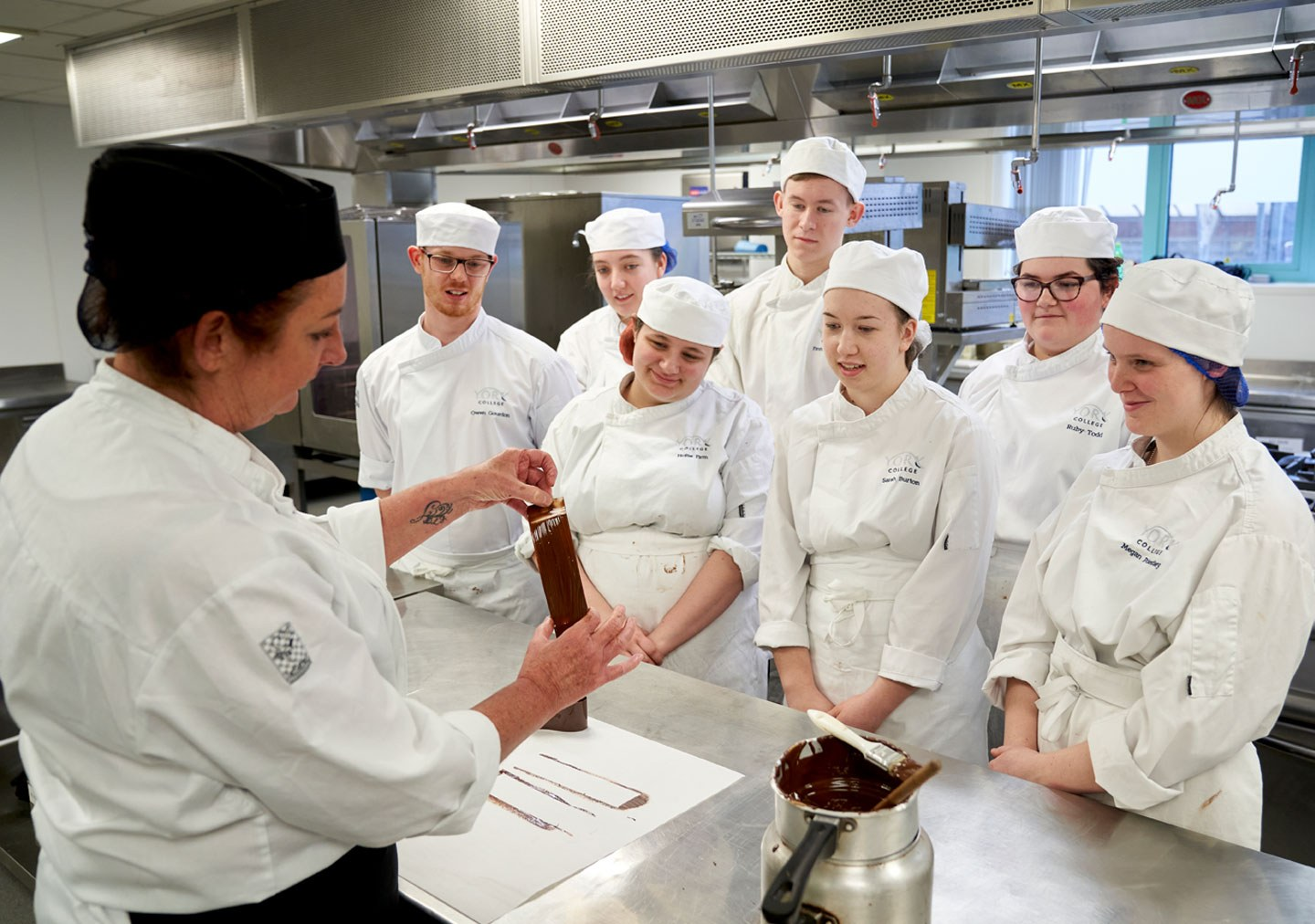 Patisserie and Confectionery students watching a demonstration by the tutor