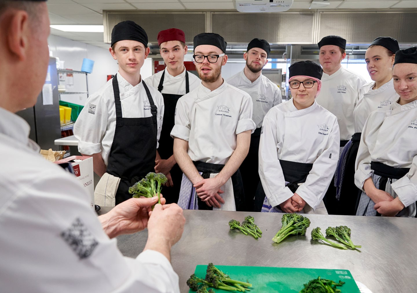Professional Cookery students watching a demonstration by the tutor