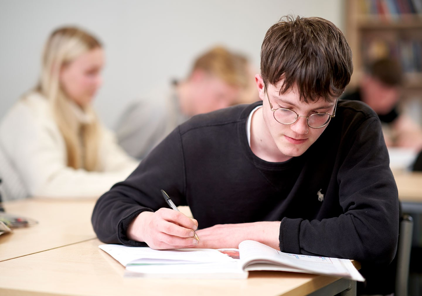 A Sociology student is taking notes from a textbook