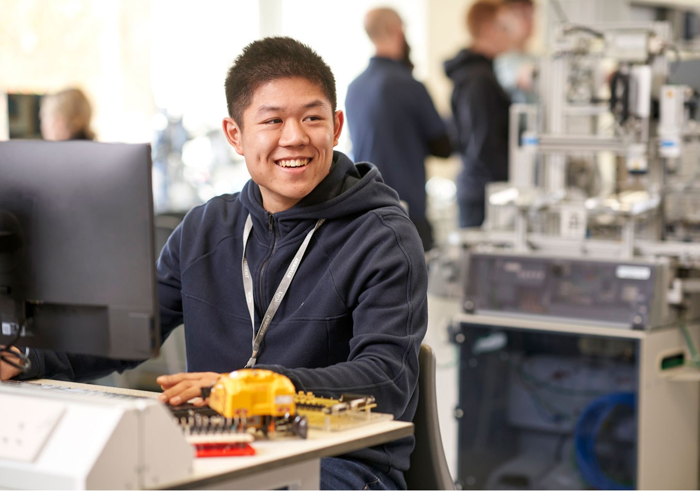 Student working at a computer in the engineering suite