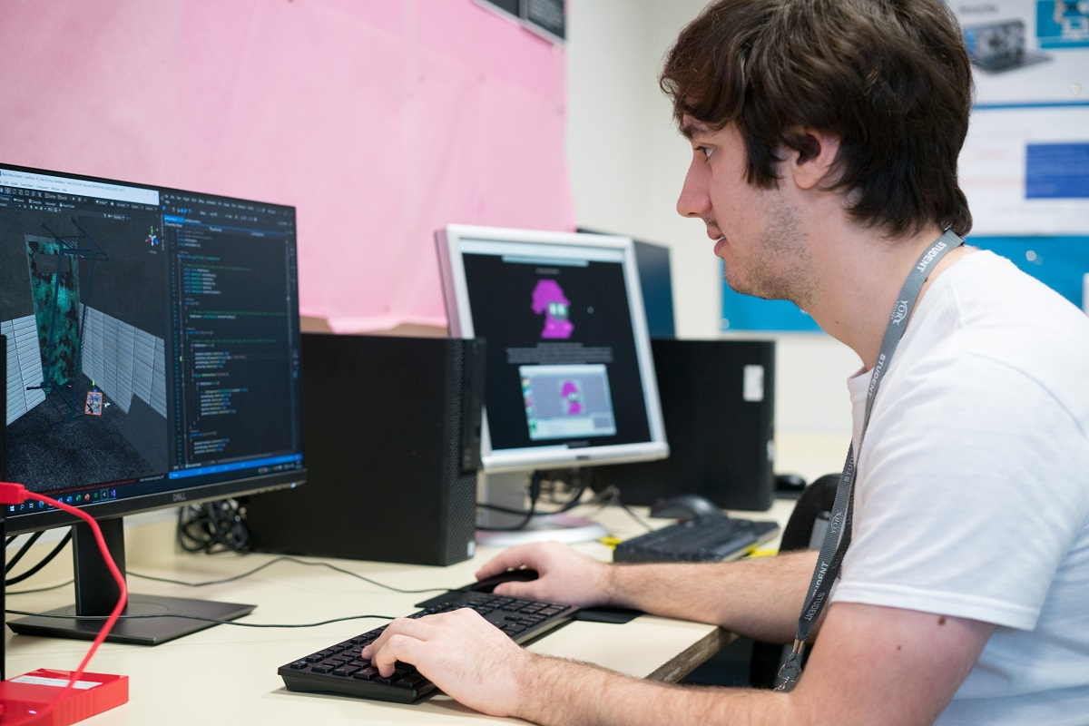 A student working on the computer game they have designed