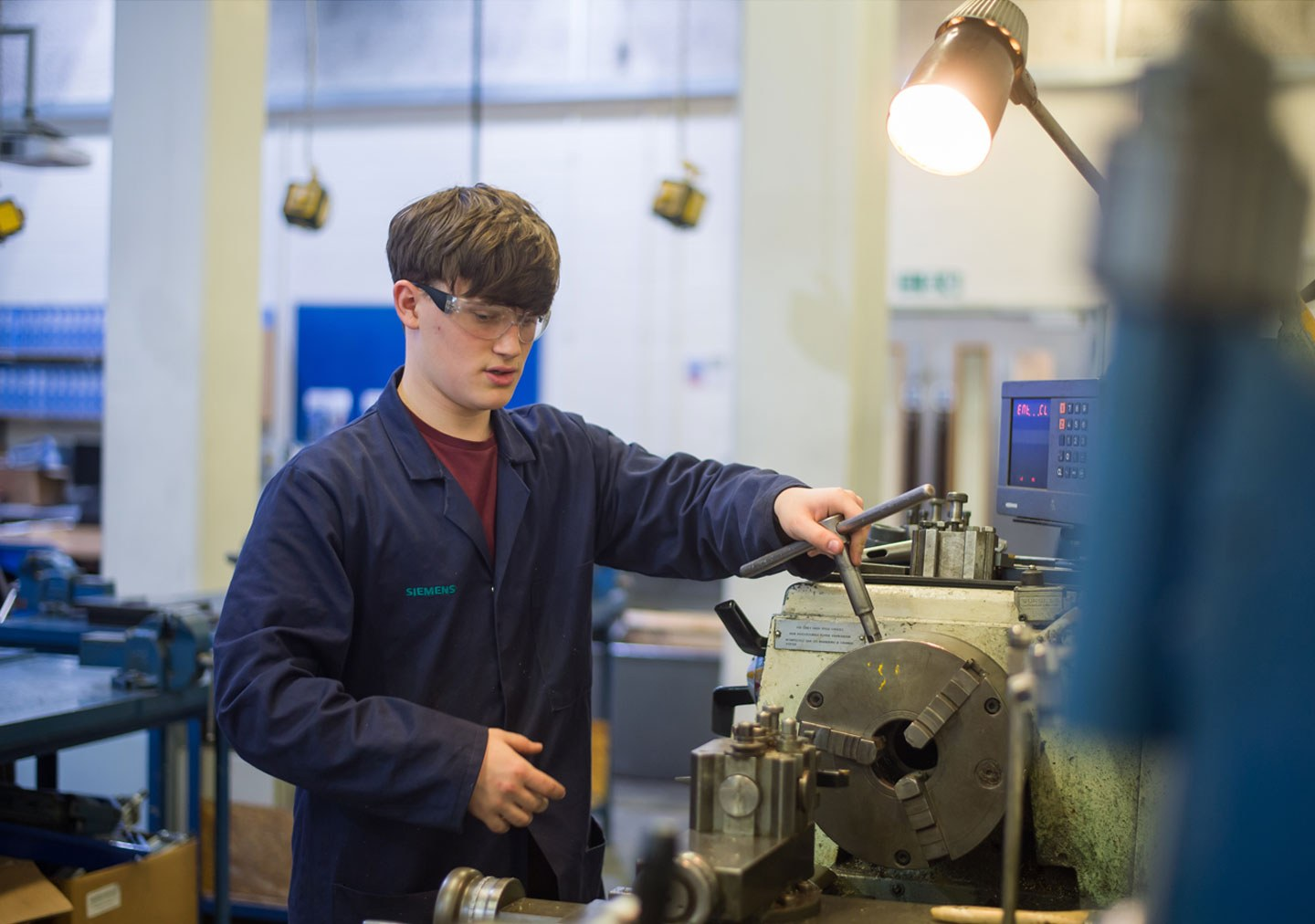 Student using the machinery in the engineering workshop