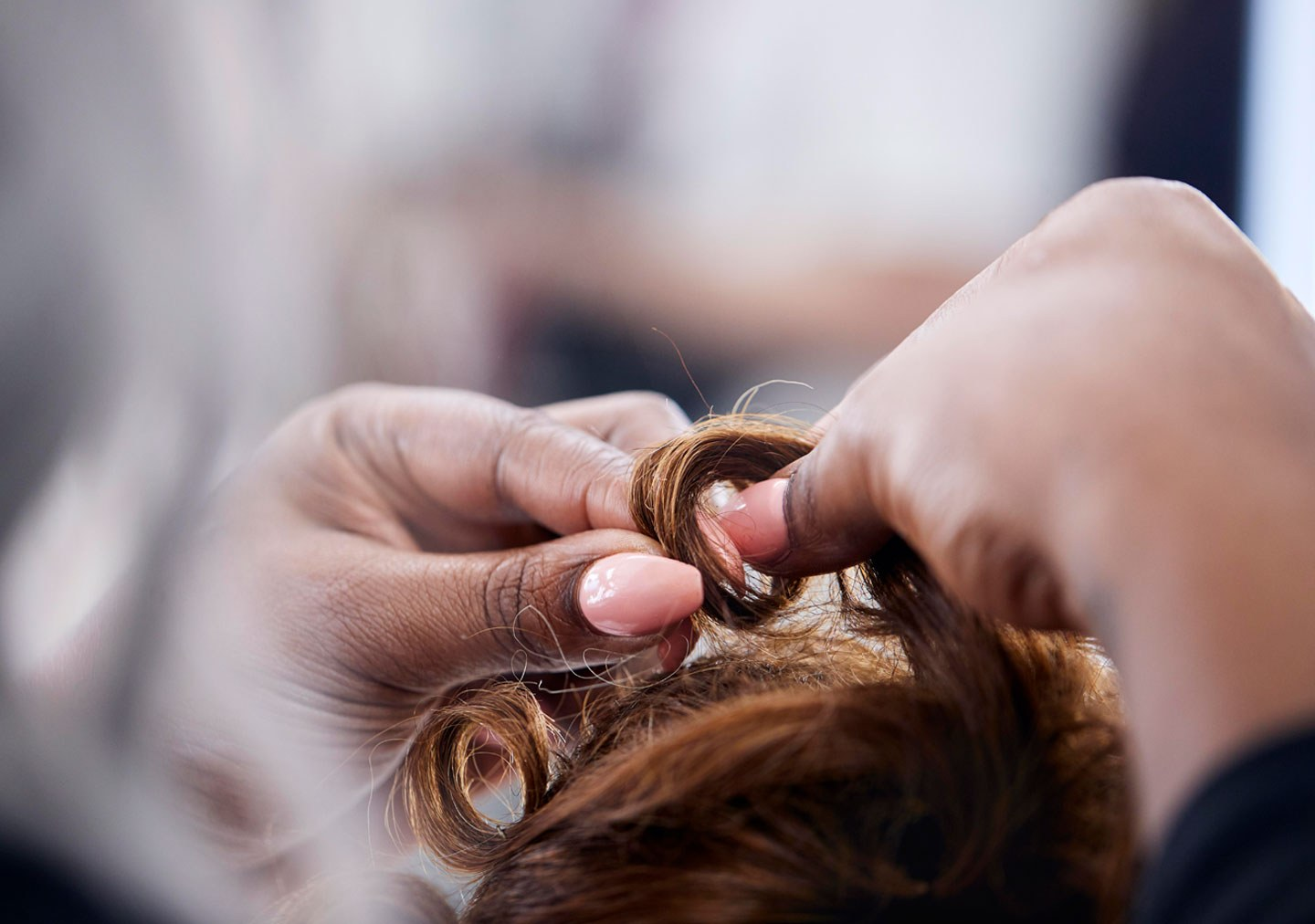 Student working on a hair style
