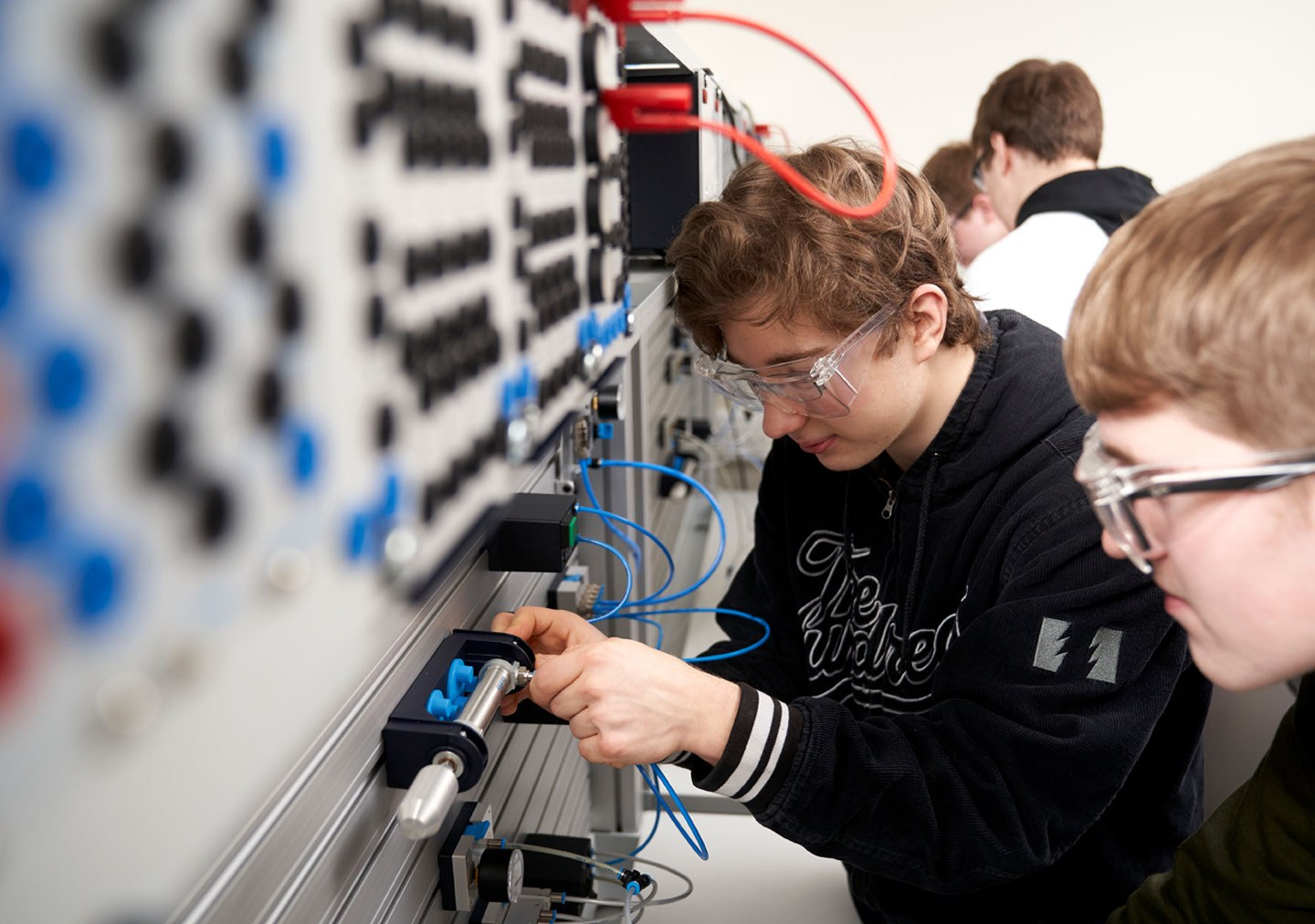 Students studying pneumatics systems