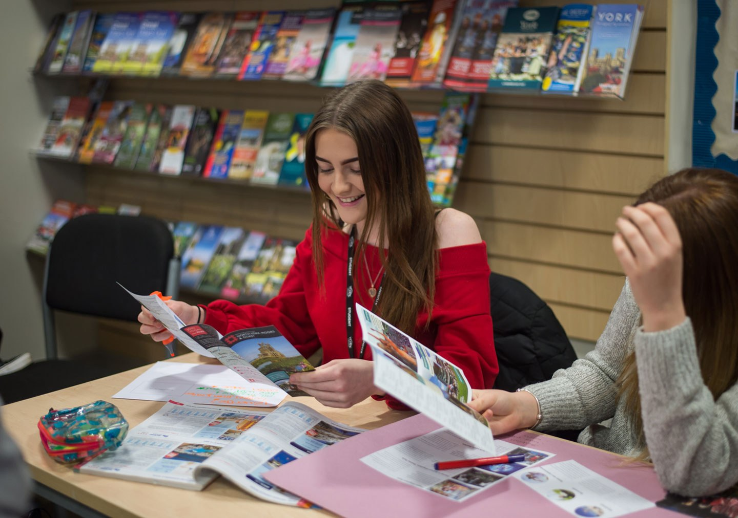 Travel and Tourism students working with travel brochures