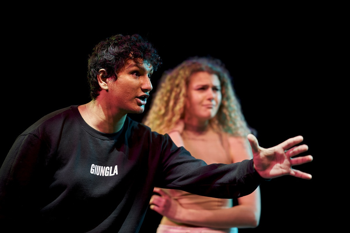 Two acting students performing in the theatre