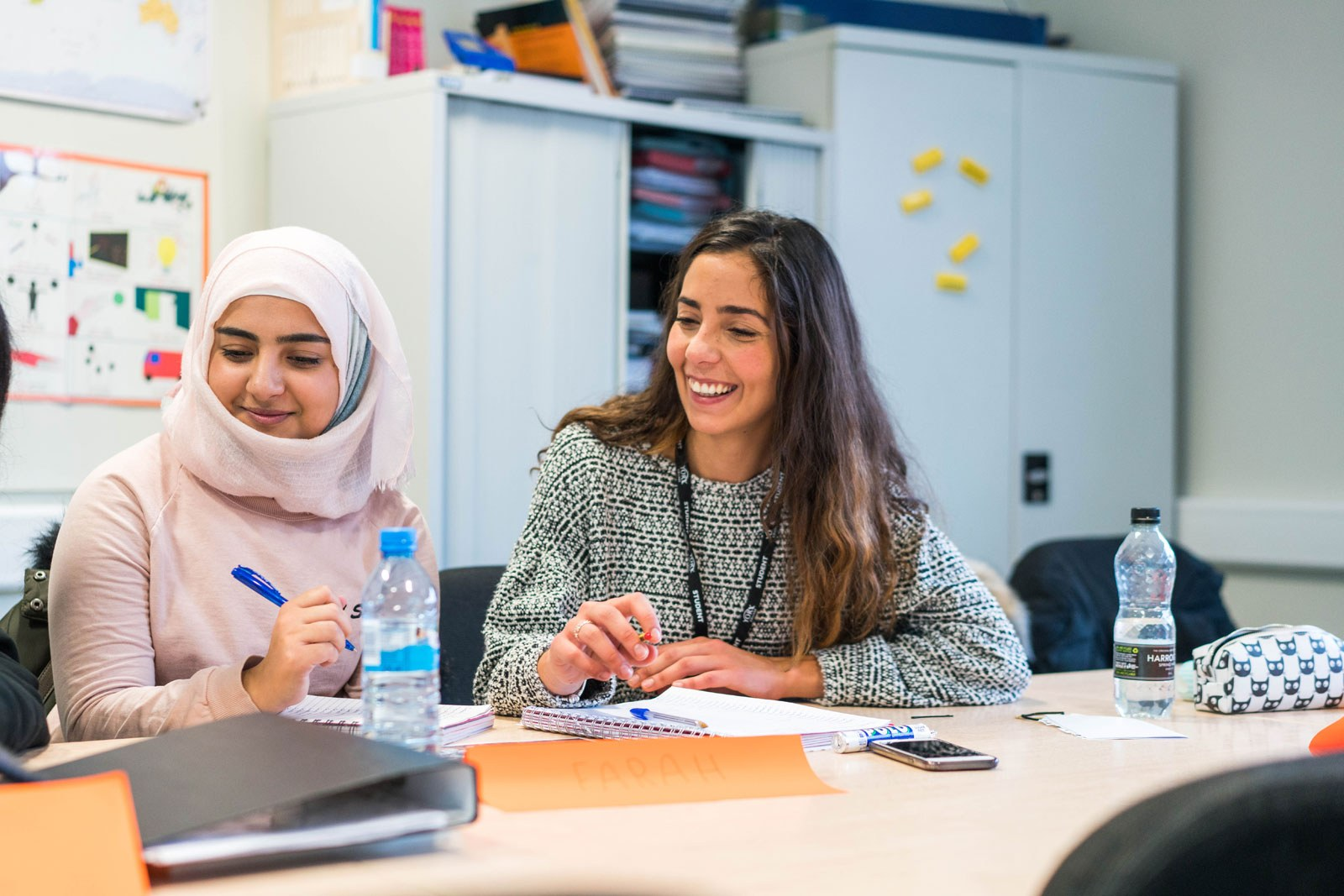 Two students in a classroom on the English Language for other speakers course
