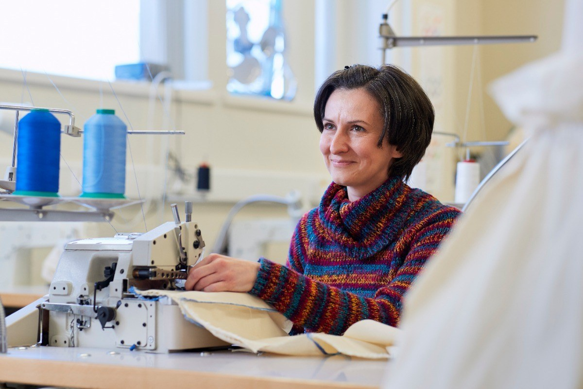 Univeristy Centre fashion student at sewing machine