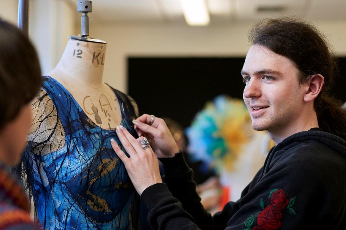 University Centre fashion student working on garment in fashion workshop