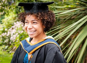 University centre student at graduation in cap and gown