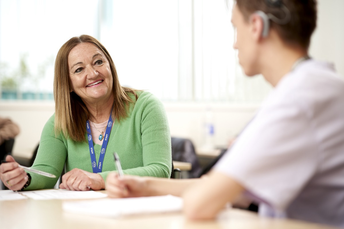 Business tutor and student in conversation