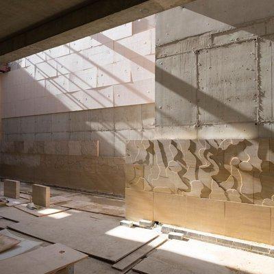 Study Centre Oct 17 interior stonework by Susanna Heron being installed