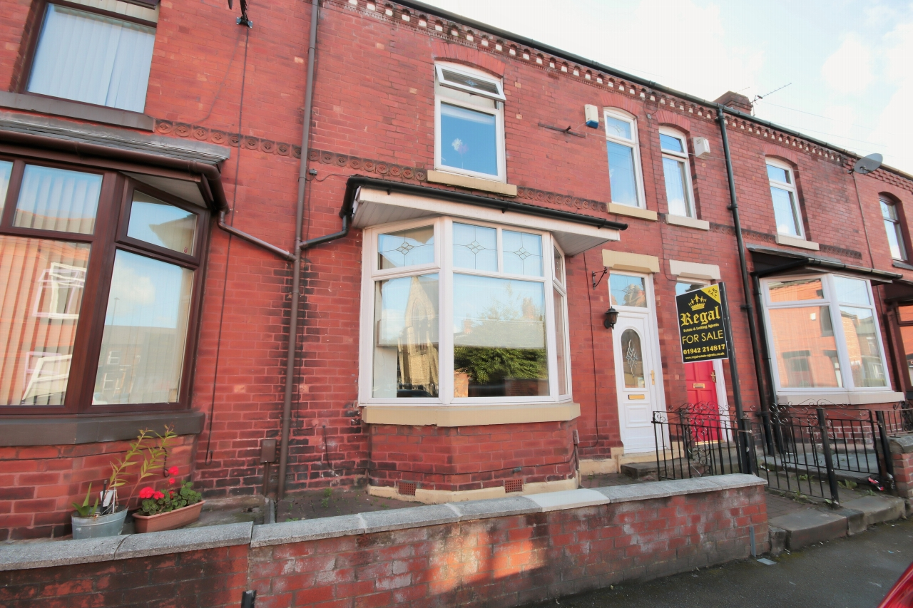 3 bedroom mid terraced house To Let in Wigan - Photograph 1.