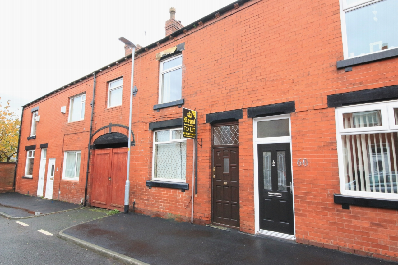 3 Bedroom Mid Terraced House - Photograph 1