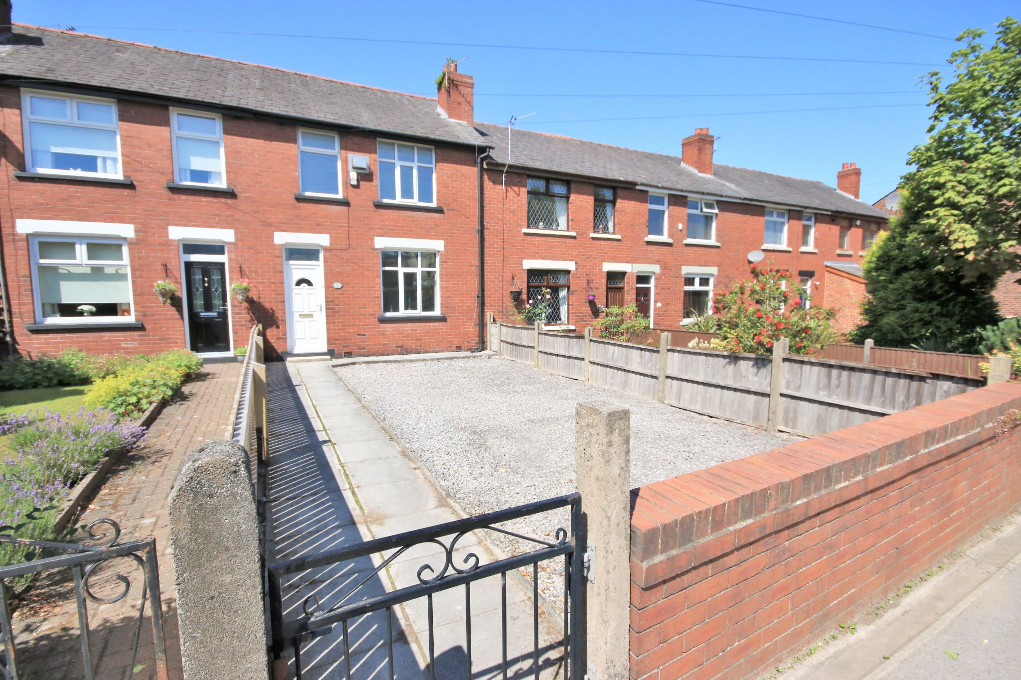 3 bedroom mid terraced house For Sale in Wigan - Photograph 1.