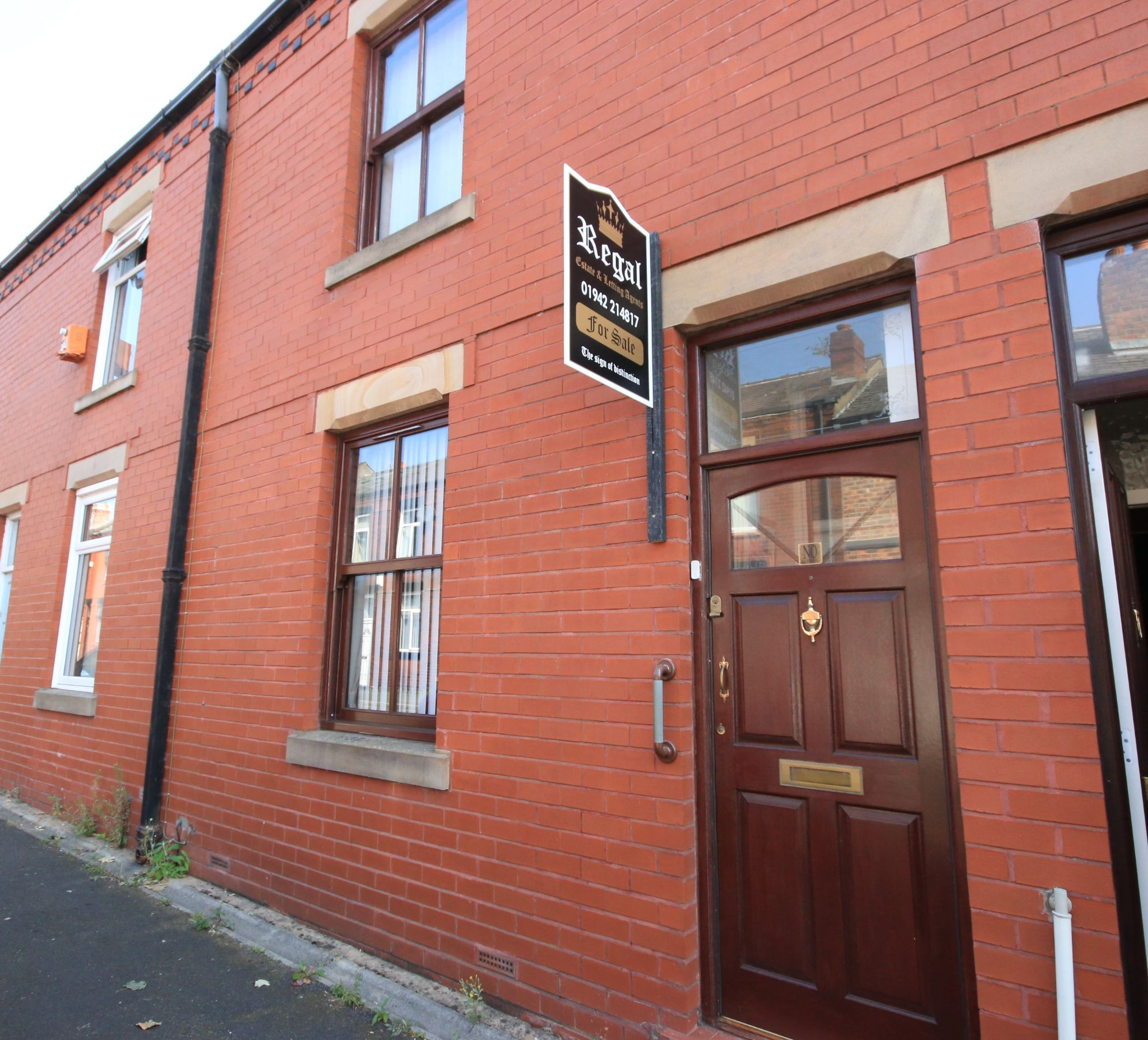 2 bedroom mid terraced house For Sale in Wigan - Photograph 1.