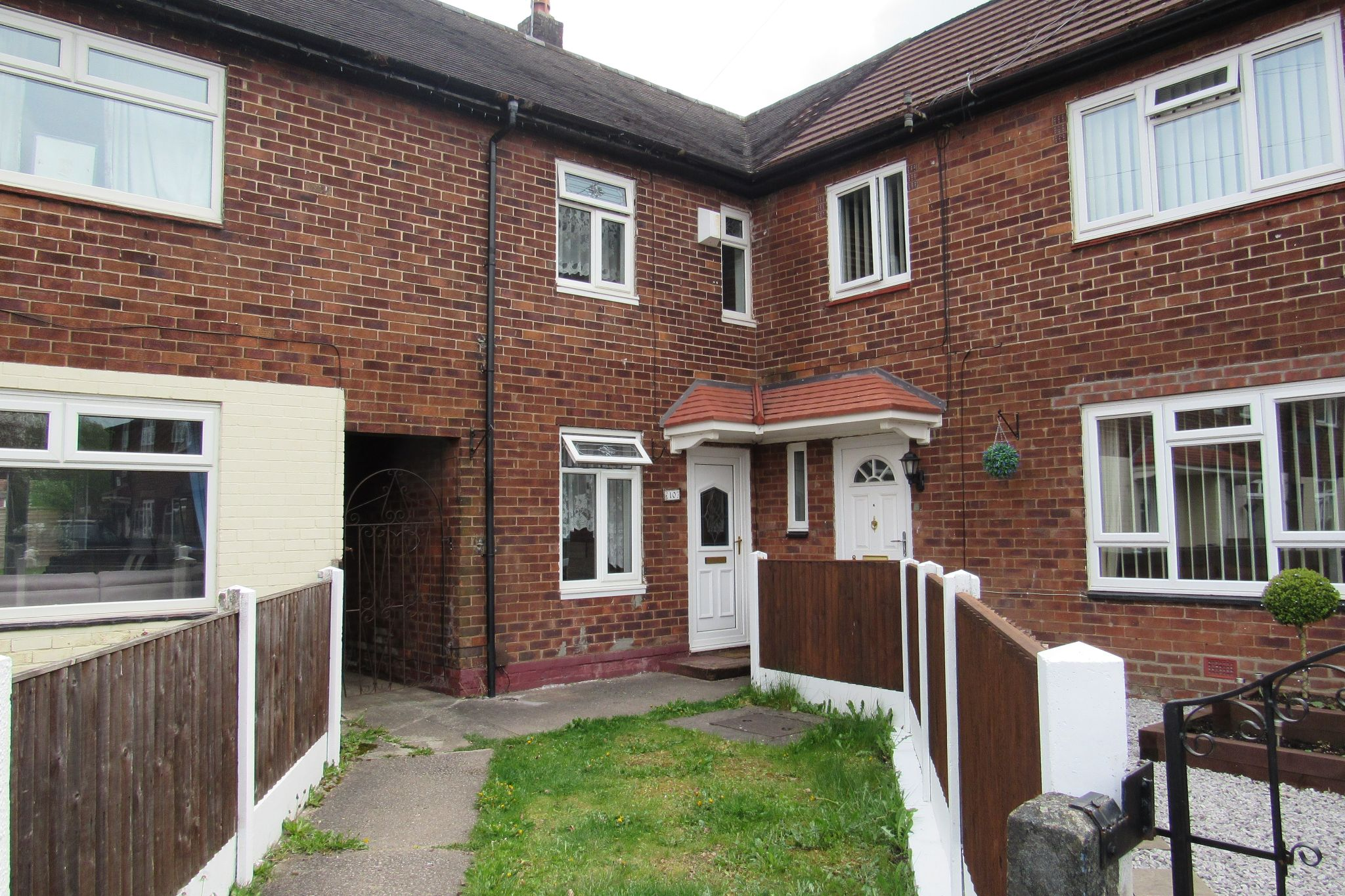 3 bedroom mid terraced house Sale Agreed in Manchester - Photograph 1.