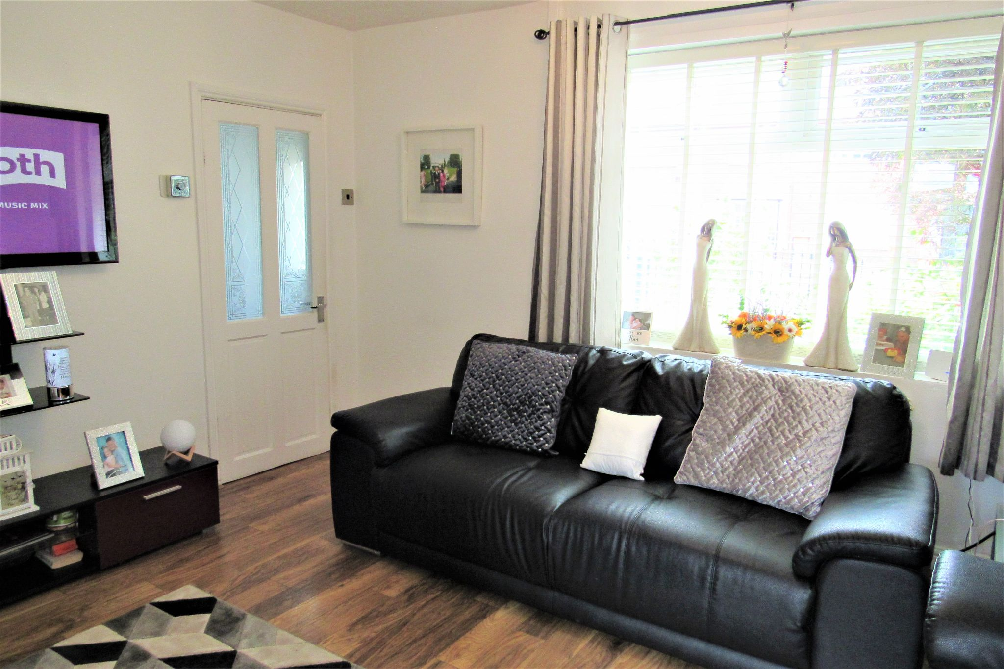 3 bedroom mid terraced house SSTC in Manchester - Photograph 2.