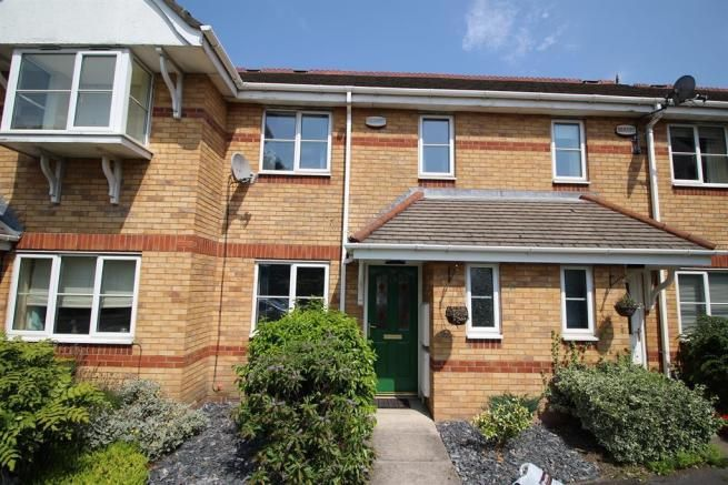 2 bedroom mid terraced house SSTC in Manchester - Photograph 1.