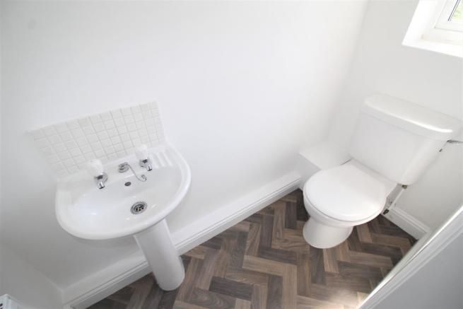 2 bedroom mid terraced house SSTC in Manchester - Photograph 3.