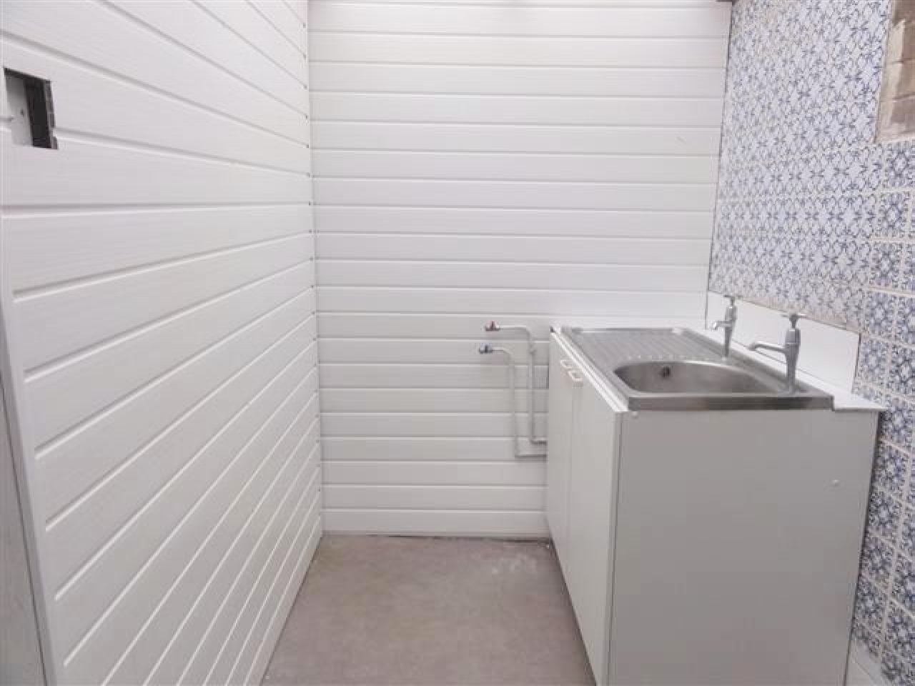 Image 1 of 1 of Laundry, on Accommodation Comprising for