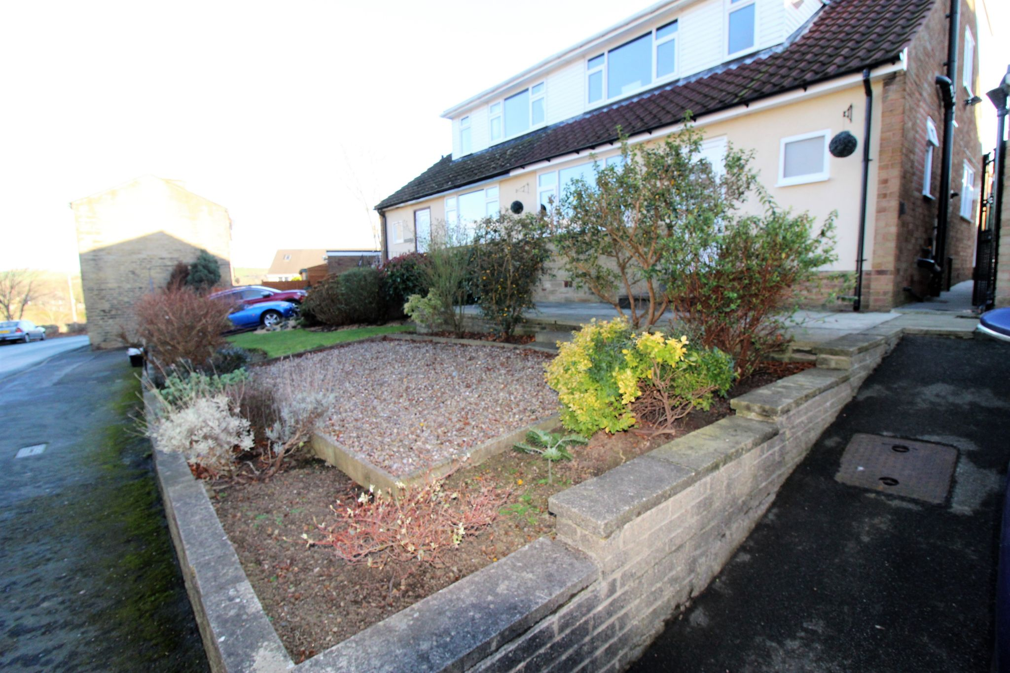 4 bedroom semi-detached bungalow SSTC in Brighouse - Front garden