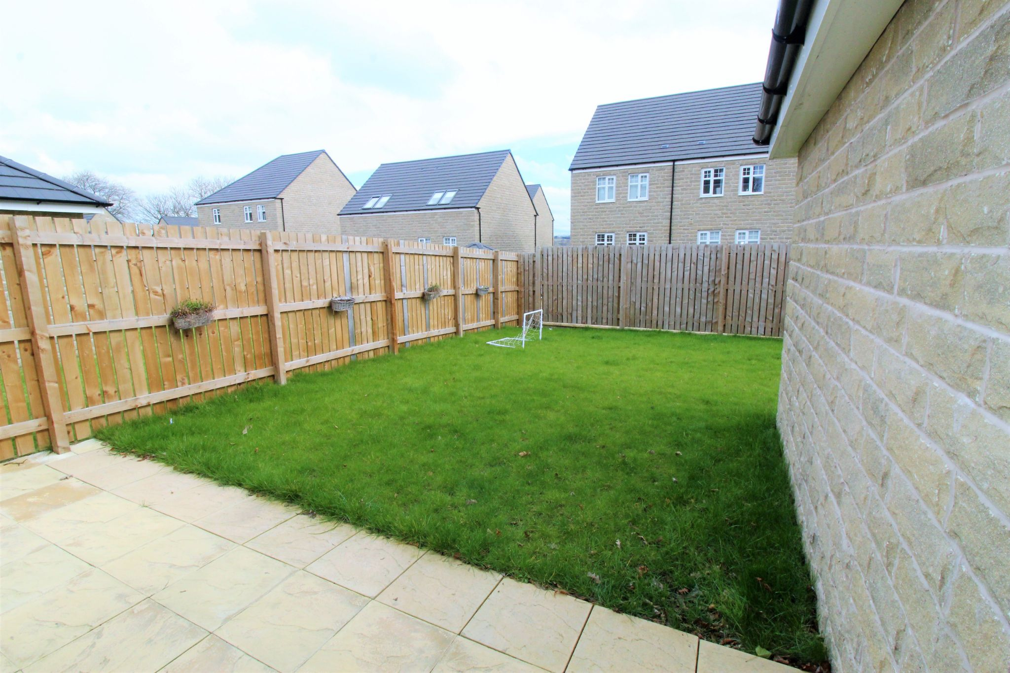 4 bedroom semi-detached house For Sale in Halifax - Rear garden and patio