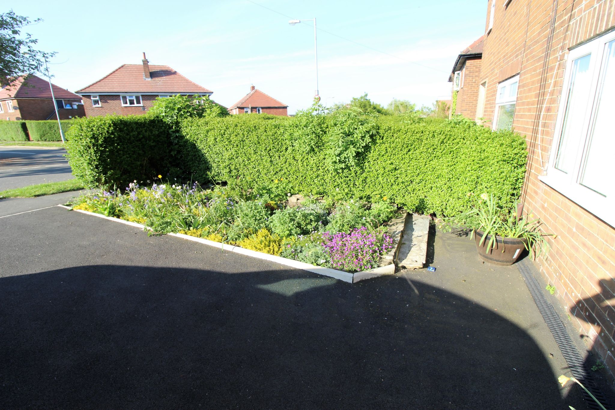 3 bedroom semi-detached house SSTC in Brighouse - Front drive and flower bed