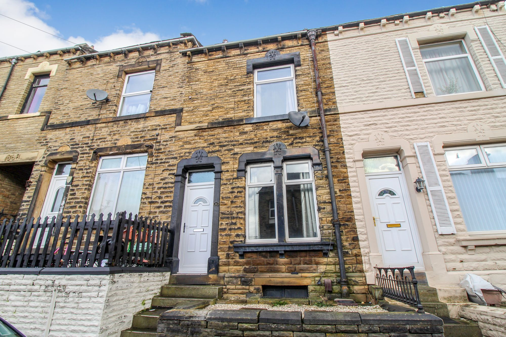 4 bedroom mid terraced house SSTC in Brighouse - Photograph 1