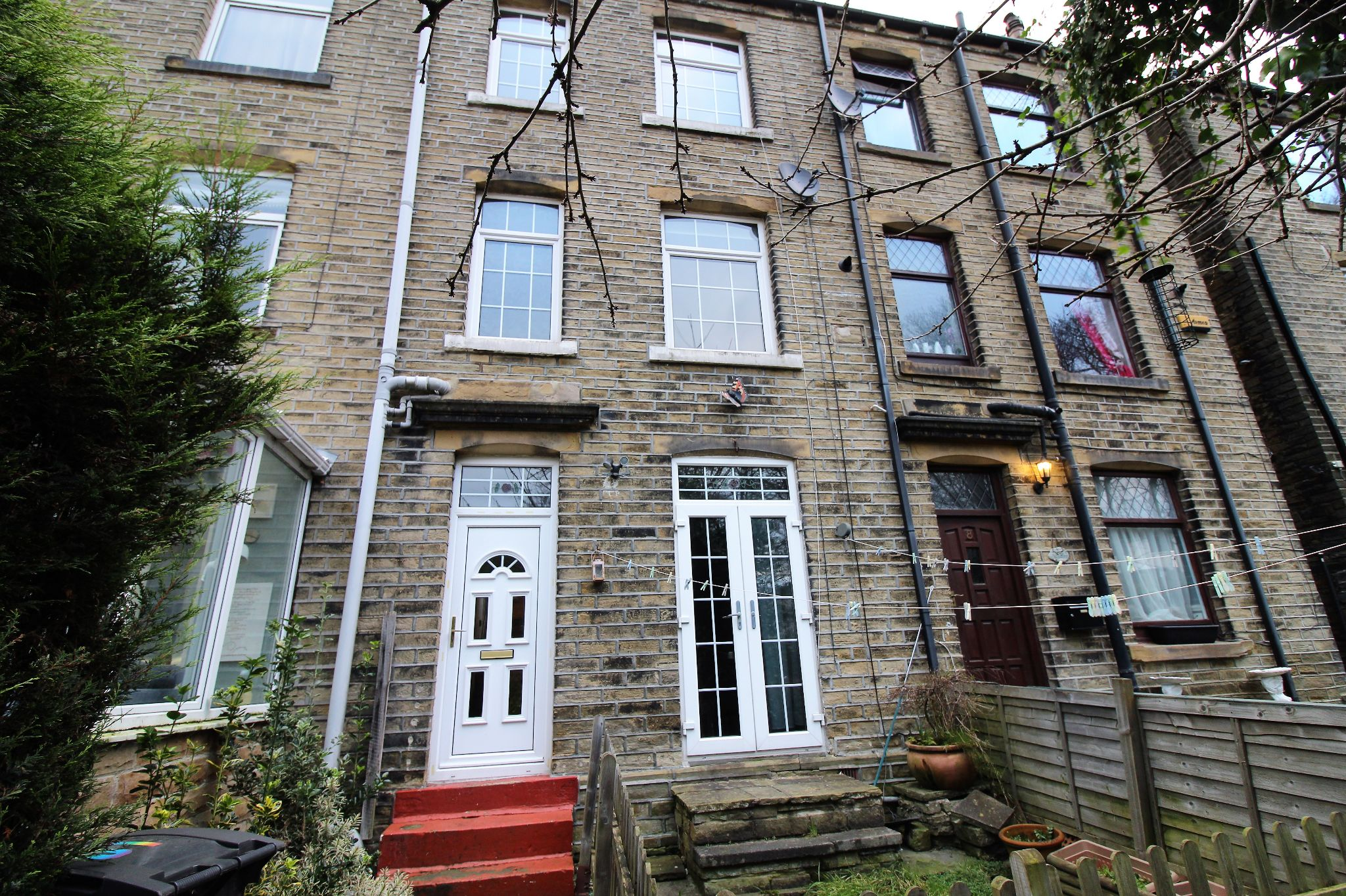3 bedroom mid terraced house To Let in Brighouse - Front