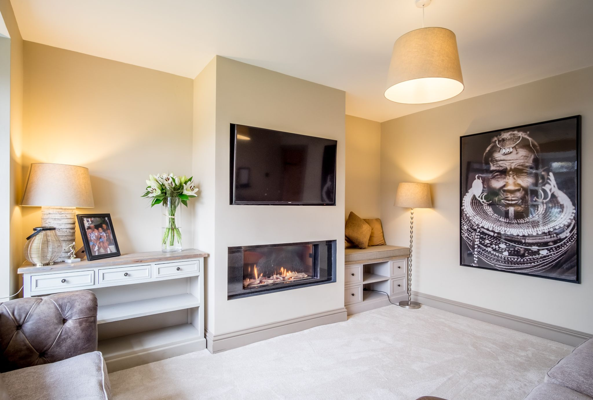 3 bedroom mid terraced house For Sale in Halifax - Lounge with the contemporary log fire