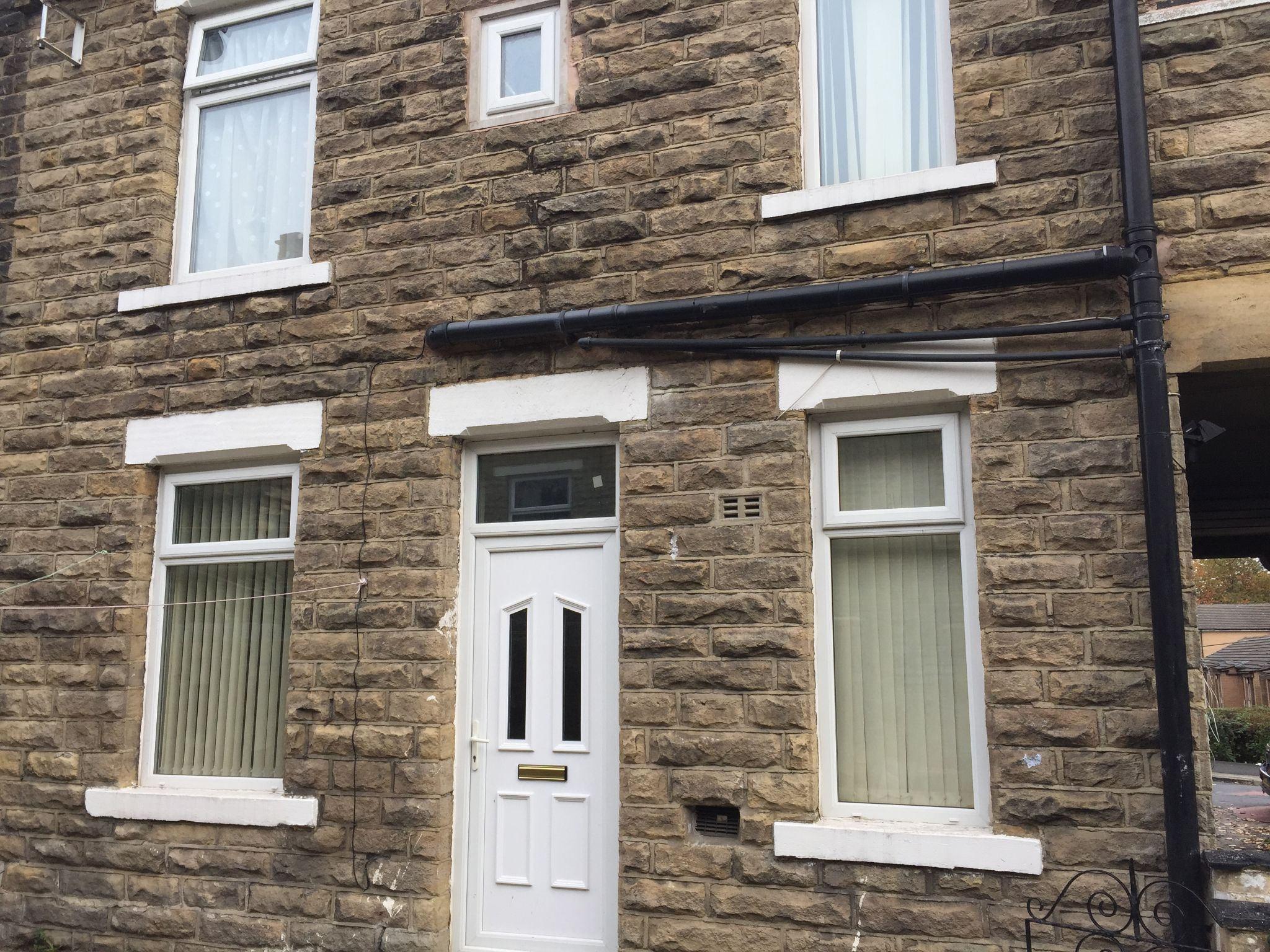 2 bedroom mid terraced house in Bradford - Photograph 1.