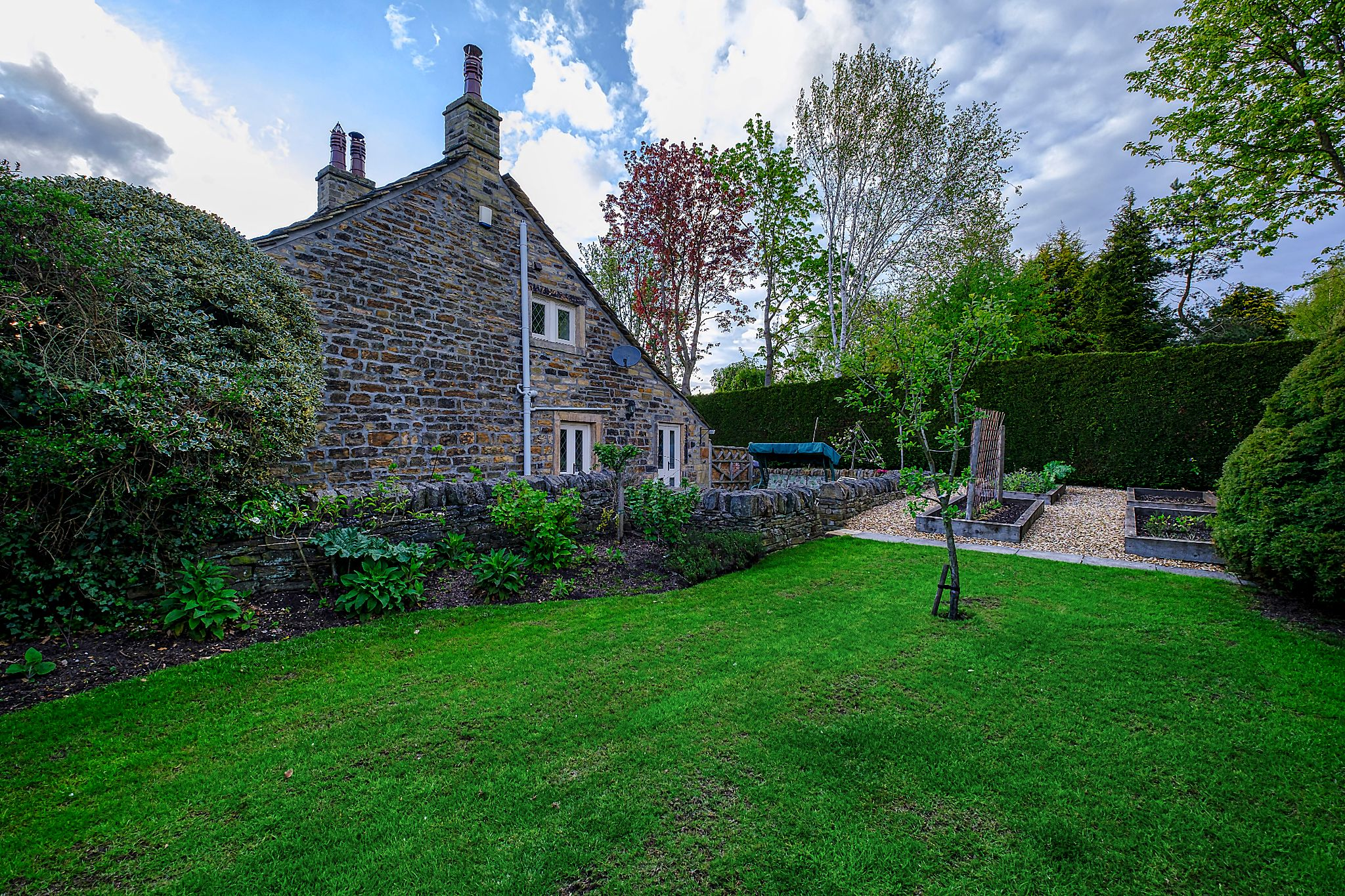 Farm House For Sale in Halifax - Side gdn 3.