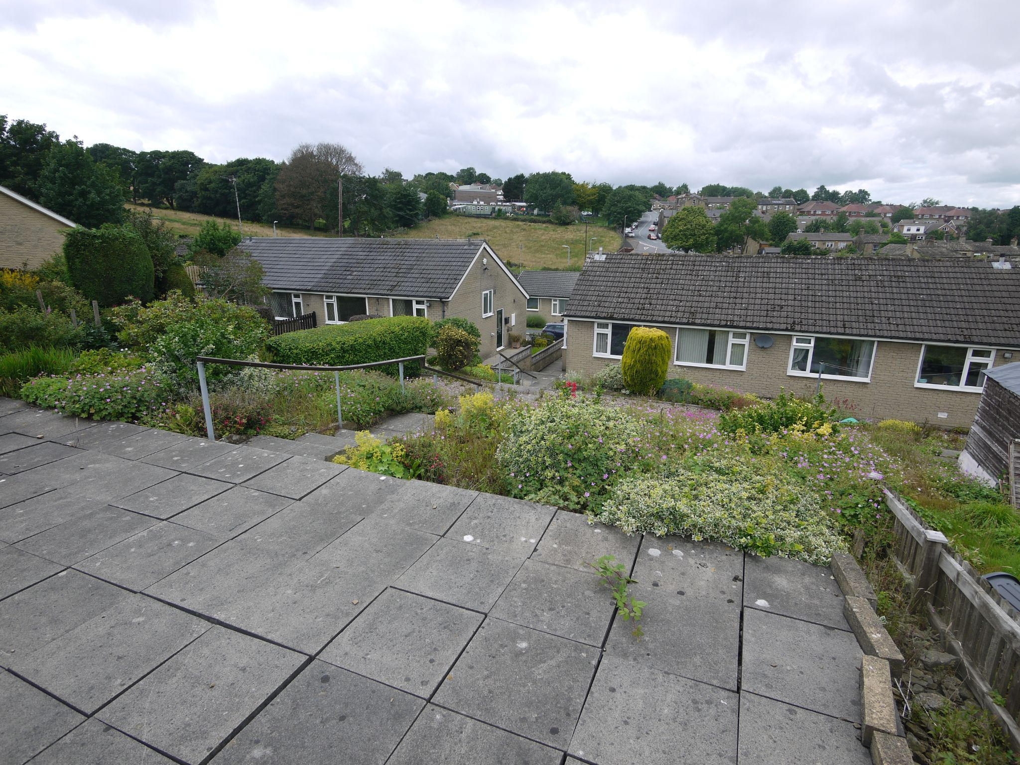 2 bedroom semi-detached bungalow SSTC in Brighouse - Rear and view.