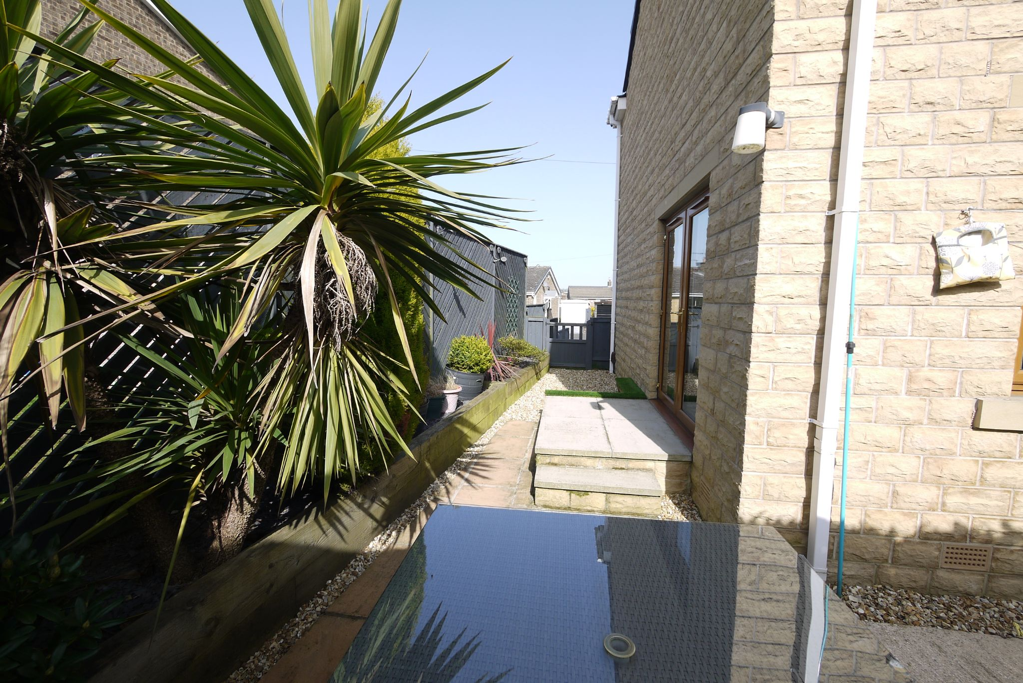 4 bedroom detached house SSTC in Brighouse - Side garden.