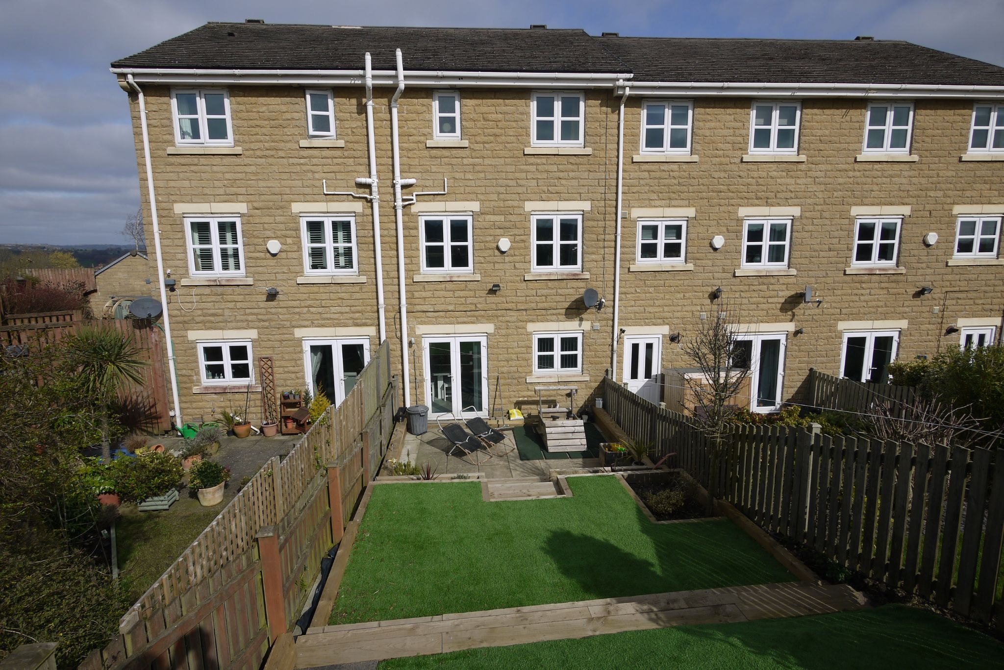 4 bedroom town house SSTC in Brighouse - Rear.