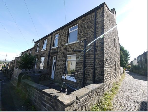 2 bedroom end terraced house SSTC in Huddersfield - Photograph 1.