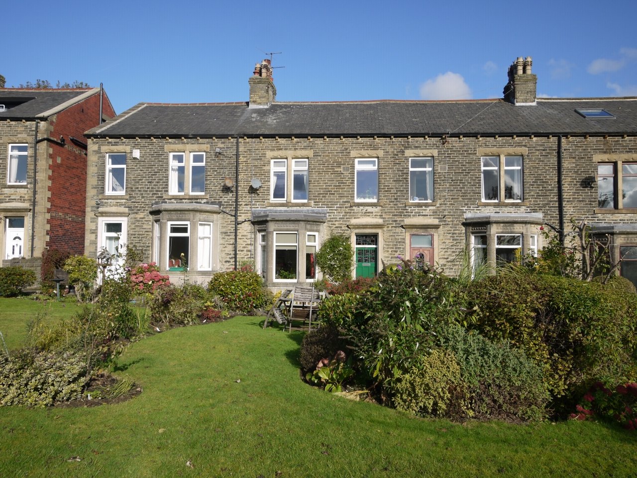 4 bedroom mid terraced house SSTC in Halifax - Photograph 1.