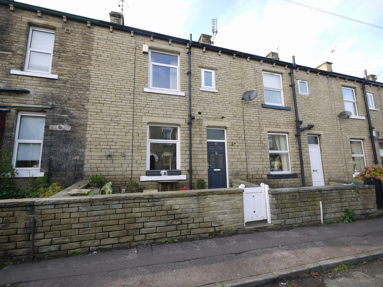 3 bedroom mid terraced house SSTC in Brighouse - Photograph 1.