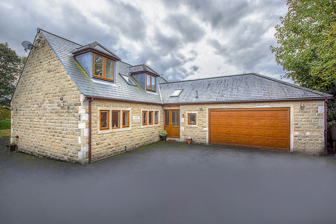 5 bedroom detached house For Sale in Brighouse - Photograph 1.