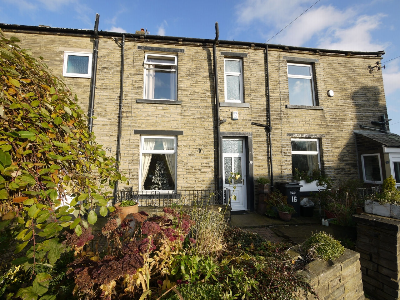4 bedroom mid terraced house SSTC in Brighouse - Photograph 1.