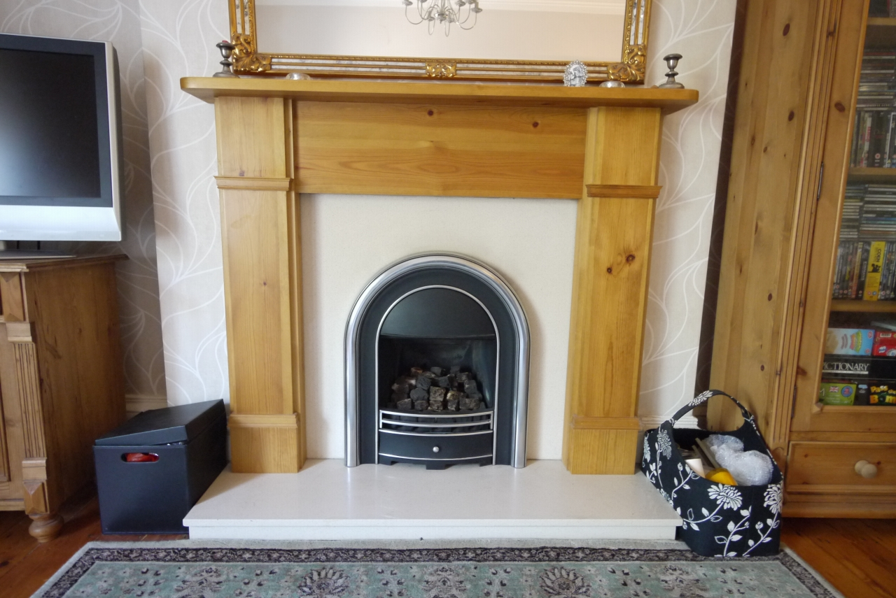 3 bedroom end terraced house SSTC in Brighouse - Lounge fireplace.