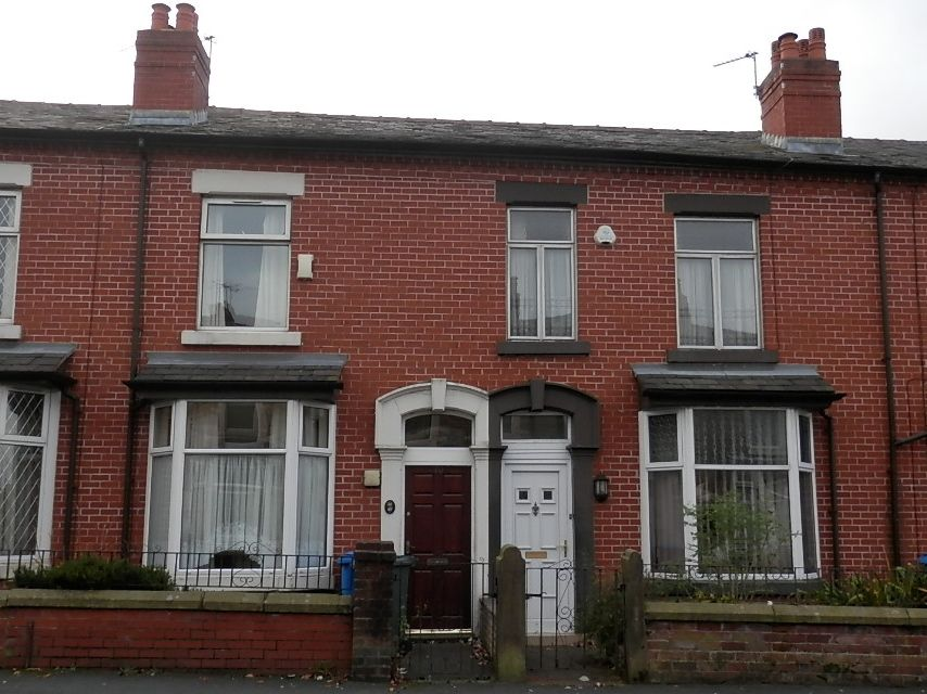 2 bedroom mid terraced house in Chorley - Photograph 1.
