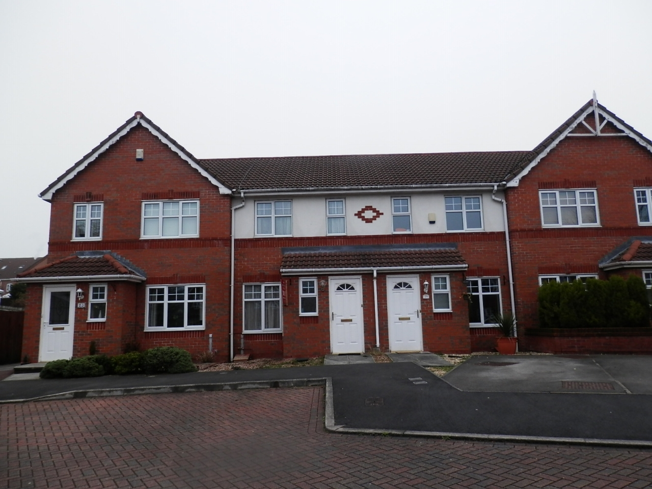 2 bedroom town house in Chorley - Photograph 1.