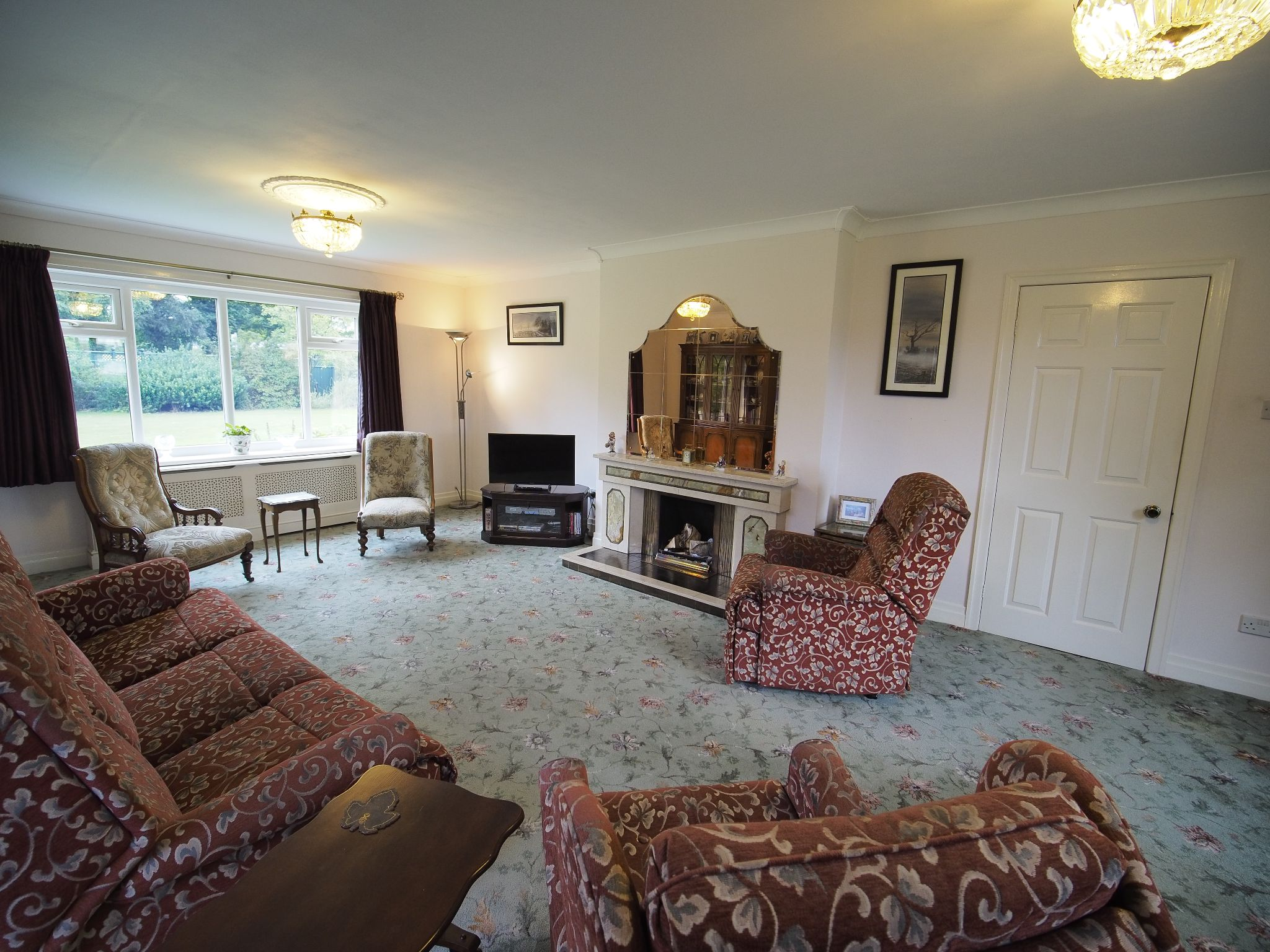 4 bedroom detached house For Sale in Willington - Lounge with coal fire.