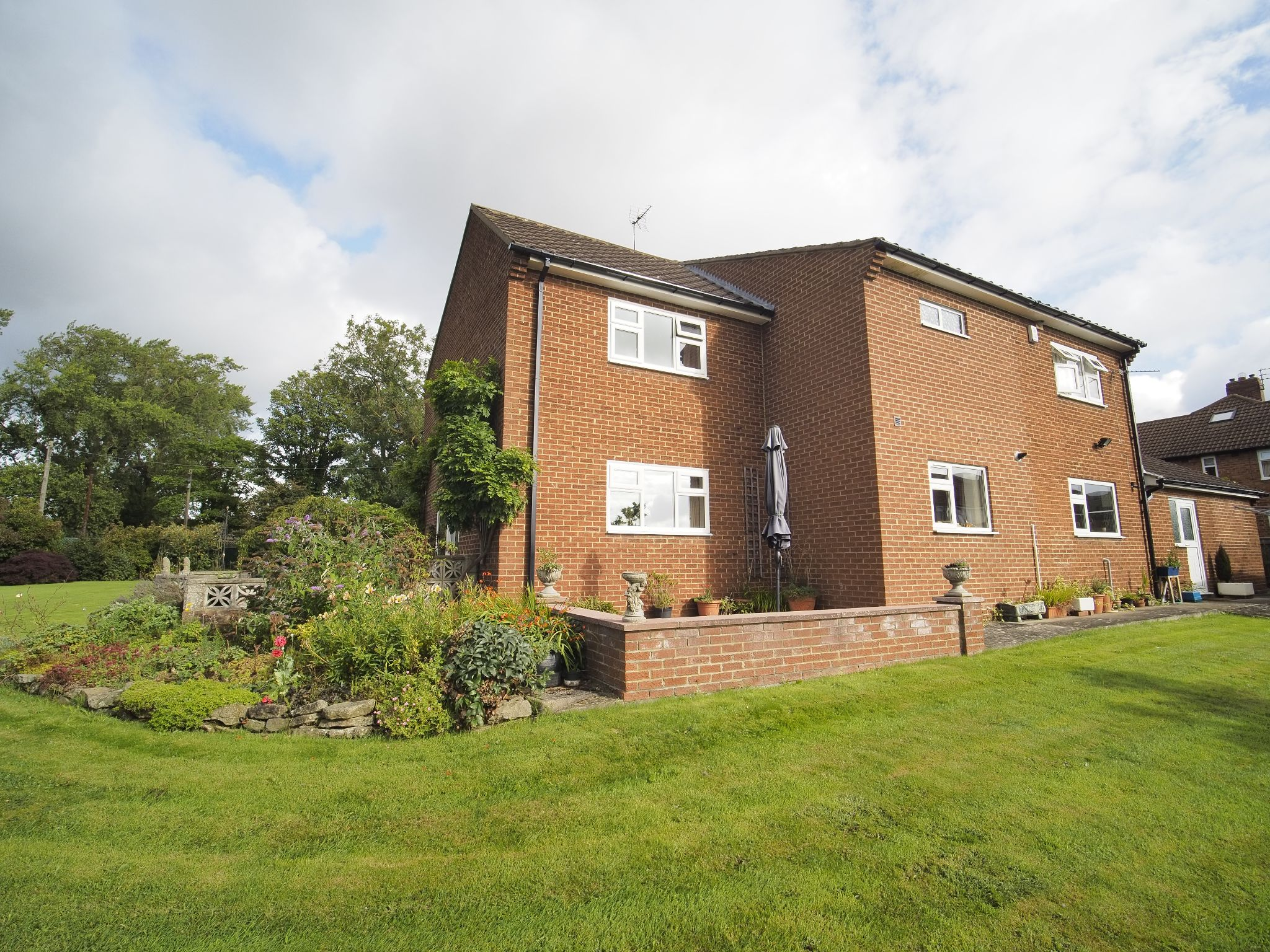 4 bedroom detached house For Sale in Willington - Looking to the house from garden.