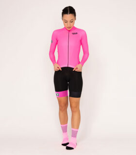 nicole pugson wears the stolen goat core fitch pink bodyline jersey and shorts and pink coolmax socks while posing in the studio