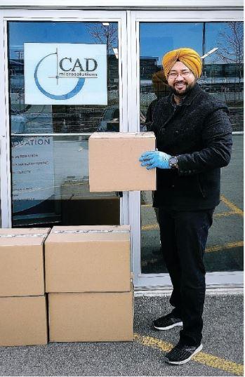 Sheridan grad Hargurdeep Singh holding a box for donation